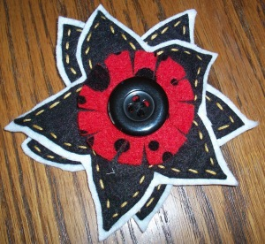 red polka dot brooch